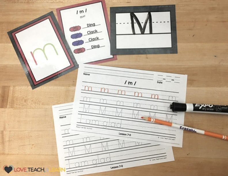 Letter M handwriting page with phonogram cards.